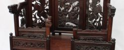 A Chinese hardwood table top shrine, with carved panels, and an arrangement of five drawers on shaped feet, 78cm high x 49.5cm wide x 33cm deep